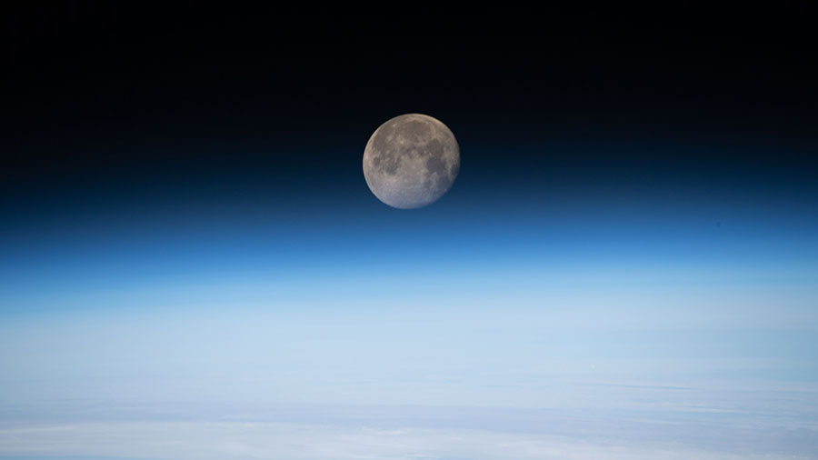 The moon is photographed in its waning gibbous phase