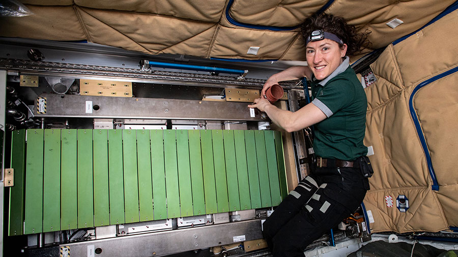 NASA astronaut Christina Koch works on the COLBERT treadmill
