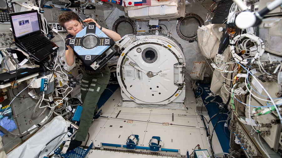 NASA astronaut Anne McClain checks out new Astrobee hardware