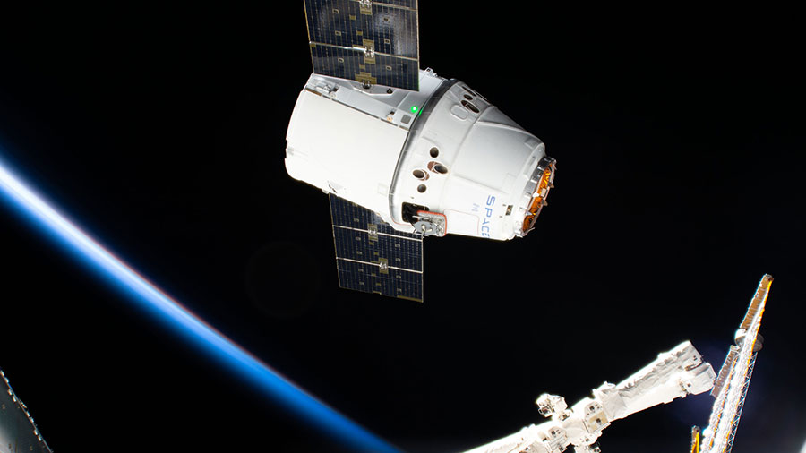 The SpaceX Dragon cargo craft approaches its capture point