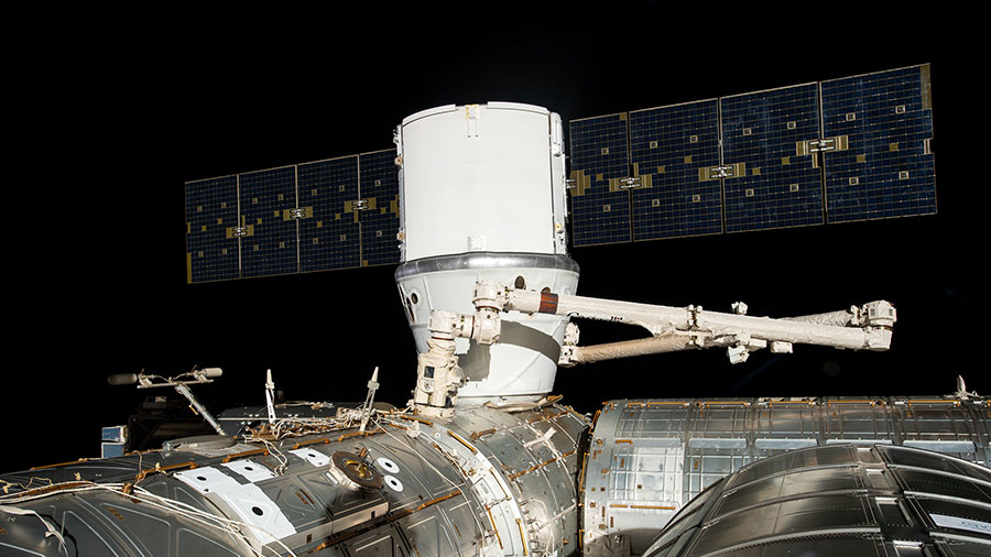 The SpaceX Dragon cargo craft is installed to the Harmony module