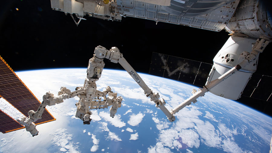 The Canadarm2 robotic arm with its robotic hand also known as Dextre