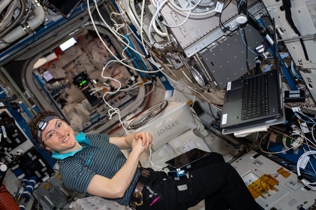NASA astronaut Christina Koch sets up Fiber Optic Production, an investigation to create optical fibers in microgravity that may exhibit superior quality to those produced on Earth. Image Credit: NASA