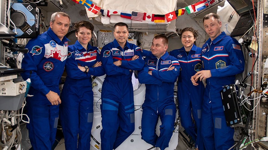 The six-member Expedition 59 crew gathers for a portrait