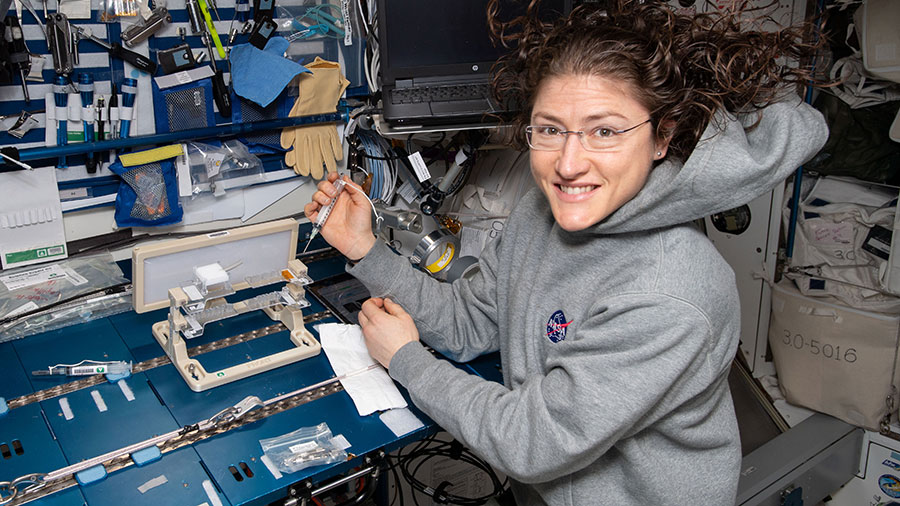 NASA astronaut Christina Koch works on the Capillary Structures experiment