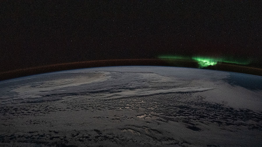 The atmospheric glow and a wispy aurora australis
