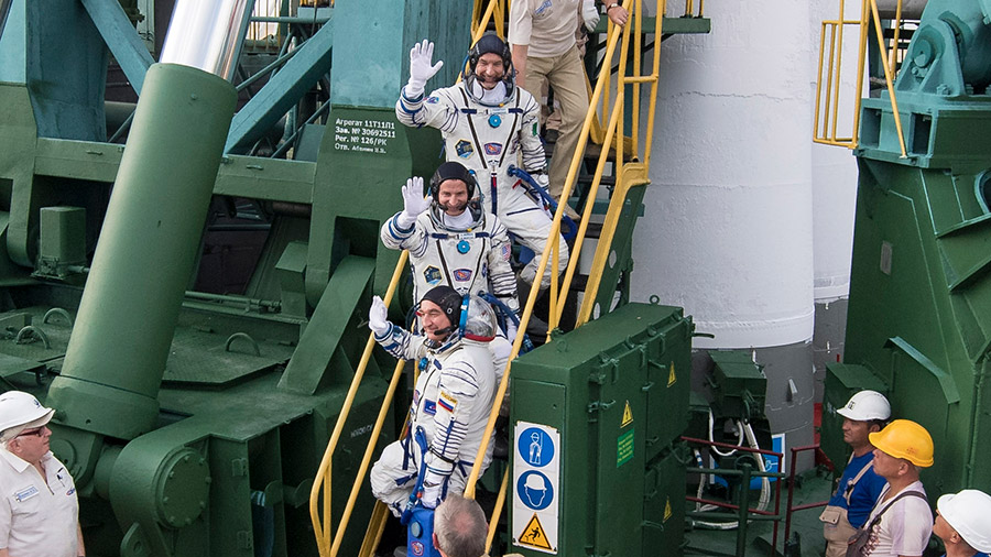 The Expedition 60 crew members boarding their Soyuz MS-13 spacecraft