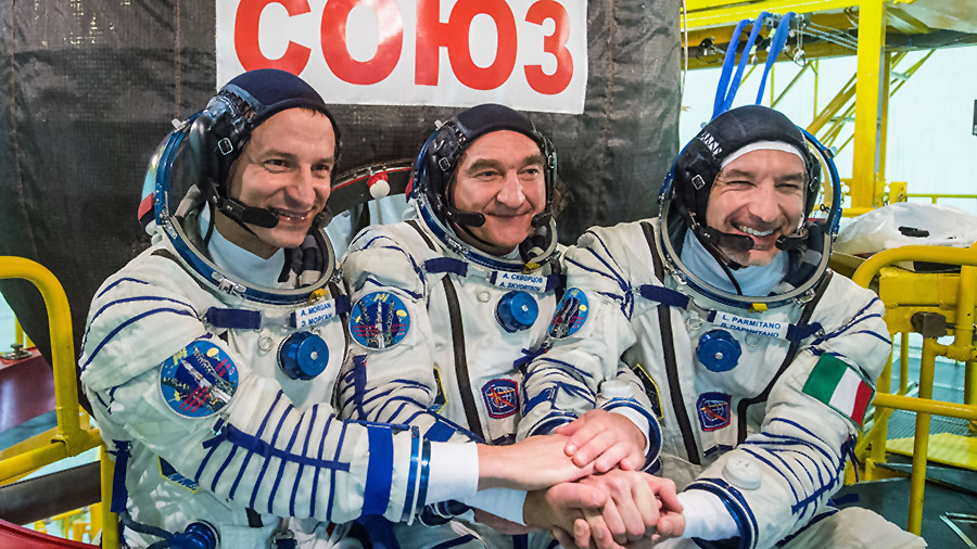 New Expedition 60 crewmembers (from left) Drew Morgan, Alexander Skvortsov and Luca Parmitano