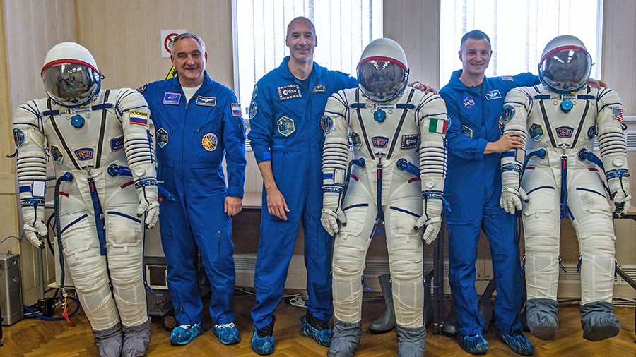 Expedition 60 crewmembers pose with their Sokol launch and entry suits