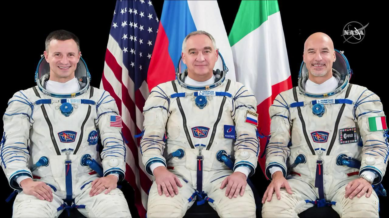 Three Expedition 60 crew members