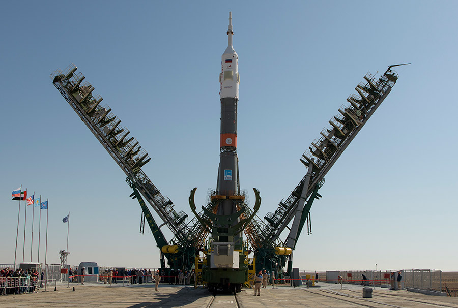 The gantry arms close around the Soyuz MS-15 rocket