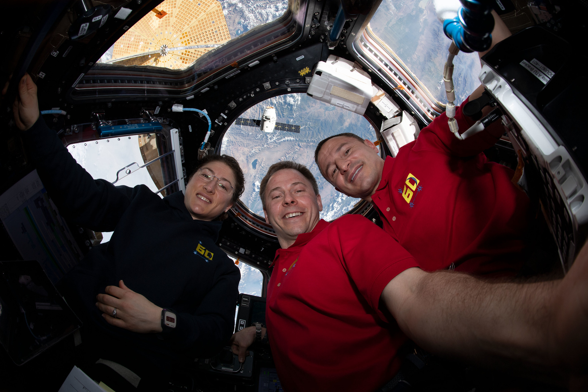 "NASA astronauts (from left) Christina Koch, Nick Hague and Andrew Morgan gather for a portrait inside the International Space Station's ""window to the world,"" the seven-windowed cupola. Credit: NASA"