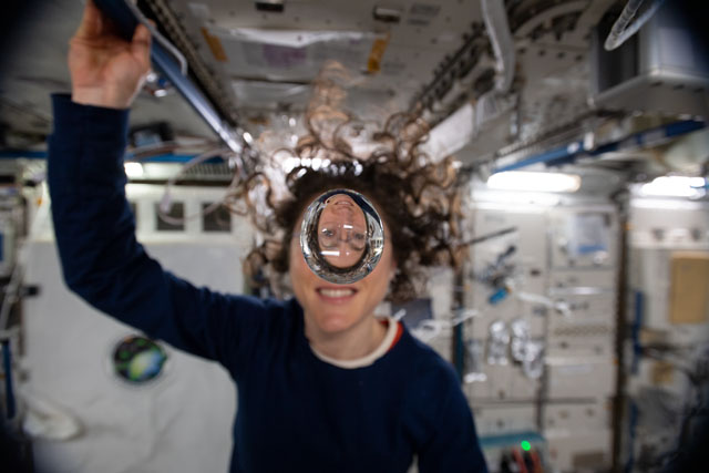 Expedition 60 Flight Engineer Christina Koch of NASA playfully demonstrates how fluids behave in the weightless environment of microgravity aboard the International Space Station. Credit: NASA