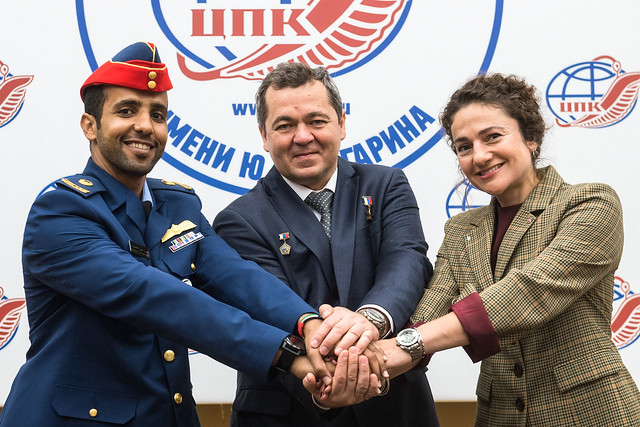 At the Gagarin Cosmonaut Training Center in Star City, Russia, spaceflight participant Hazzaa Ali Almansoori of the United Arab Emirates (left), Oleg Skripochka of Roscosmos (center) and Jessica Meir of NASA (right) pose for pictures Sept. 5 as part of a pre-flight news conference. They will launch Sept. 25 from the Baikonur Cosmodrome in Kazakhstan on the Soyuz MS-15 spacecraft for a mission on the International Space Station. Credit: Gagarin Cosmonaut Training Center