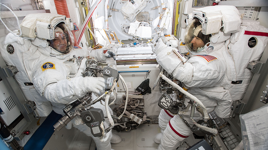 NASA astronauts Andrew Morgan (left) and Christina Koch (right) are suited up in U.S. spacesuits inside the Quest airlock for the first of five planned spacewalks that took place on Oct. 6, 2019. Image Credit: NASA