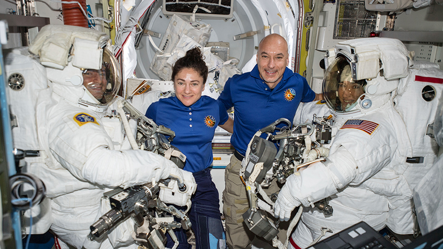 Astronauts assist spacewalkers in the Quest airlock