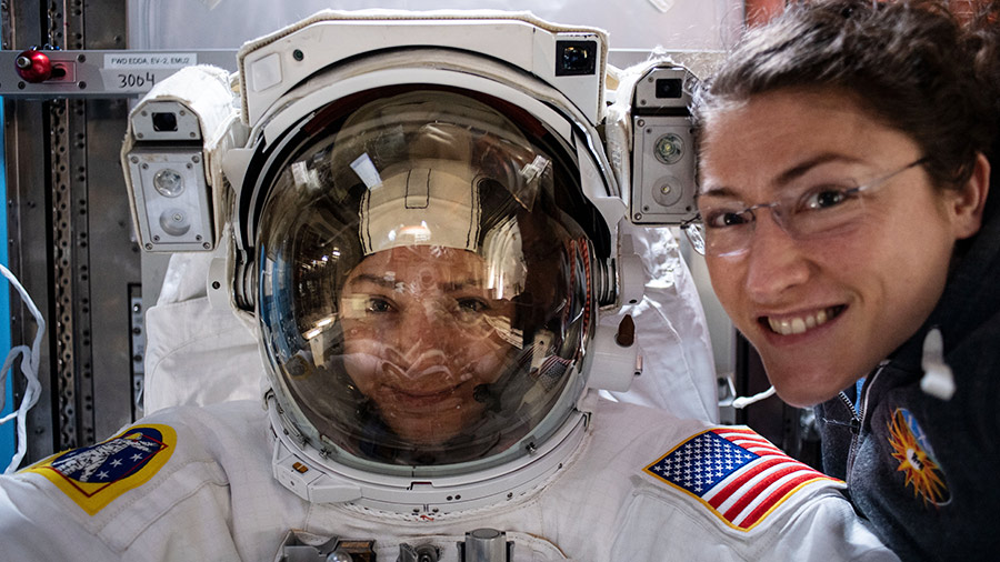 NASA astronauts Christina Koch and Jessica Meir prepare for a spacewalk