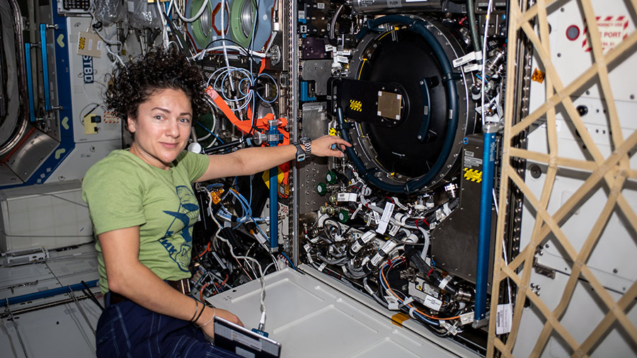 Astronaut Jessica Meir works on the Combustion Integrated Rack