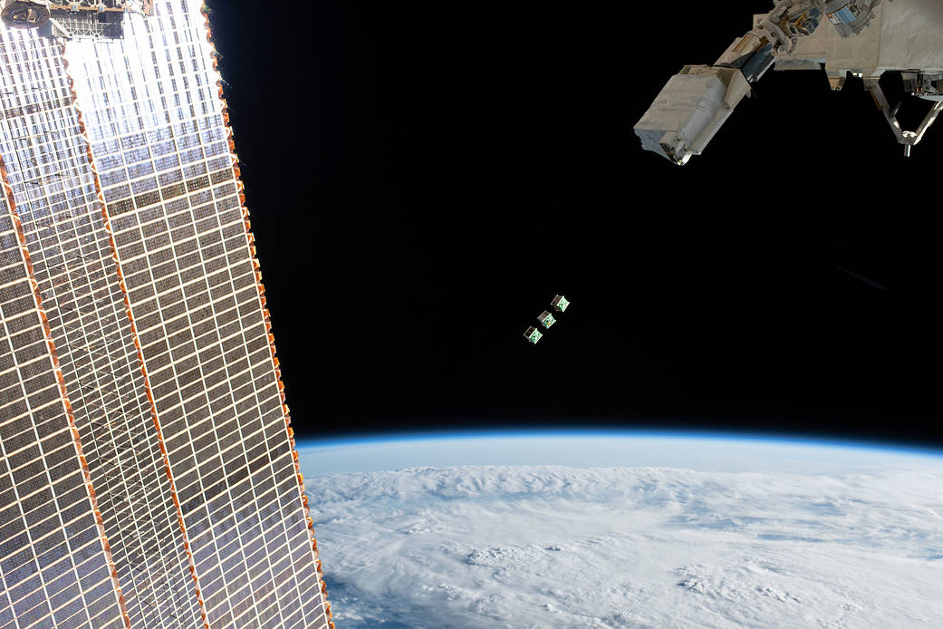 This Wednesday, three small satellites will be deployed from the International Space Station. Here, a set of three CubeSats are ejected from the Japanese Small Satellite Orbital Deployer attached to a robotic arm outside the Japan Aerospace Exploration Agency's Kibo laboratory module on June 17, 2019. Image Credit: NASA