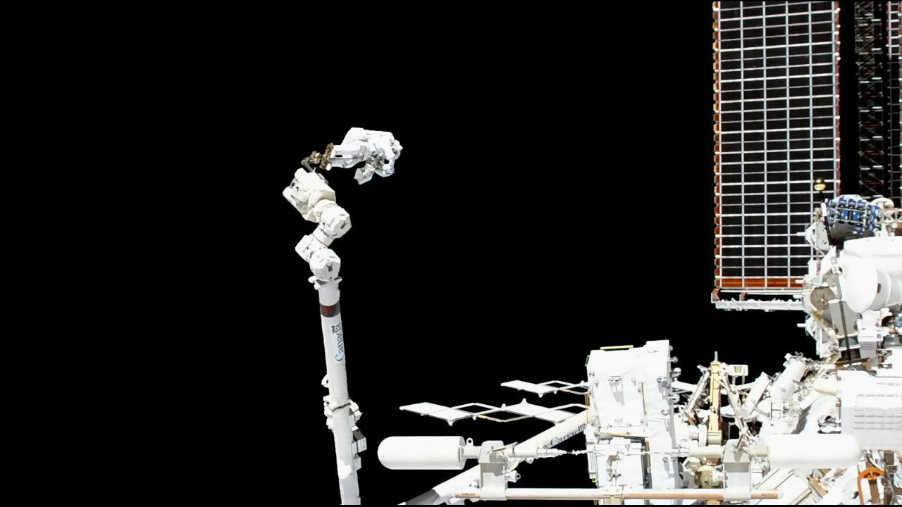 Luca Parmitano of ESA attached to the Canadarm