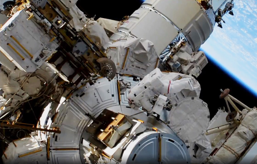 NASA astronaut Jessica Meir enters the Quest airlock