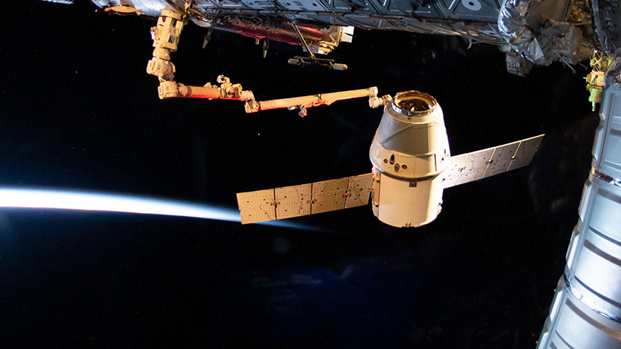 The SpaceX Dragon cargo craft is pictured moments before its release