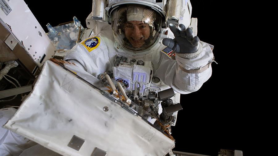 Astronaut Jessica Meir waves during a spacewalk