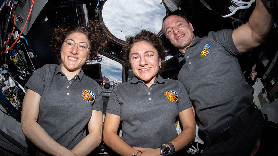 Astronauts (from left) Christina Koch, Jessica Meir and Andrew Morgan