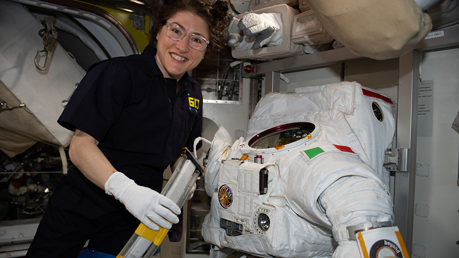 NASA astronaut Christina Koch works on a U.S. spacesuit