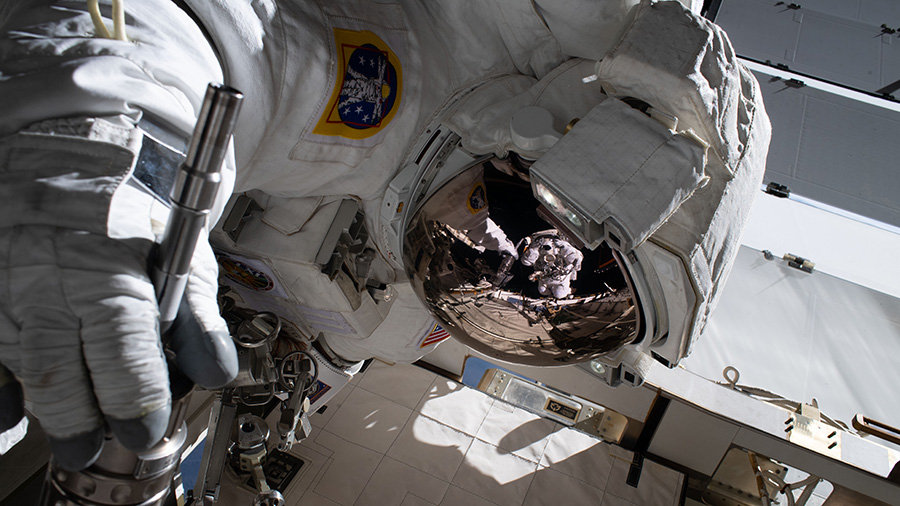 Reflection in NASA astronaut Jessica Meir's spacesuit helmet