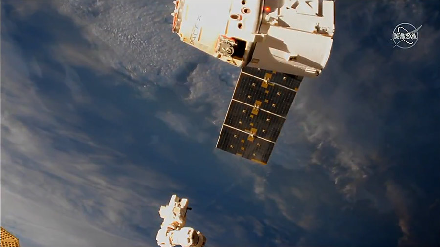The SpaceX Dragon cargo craft is pictured moments after its release