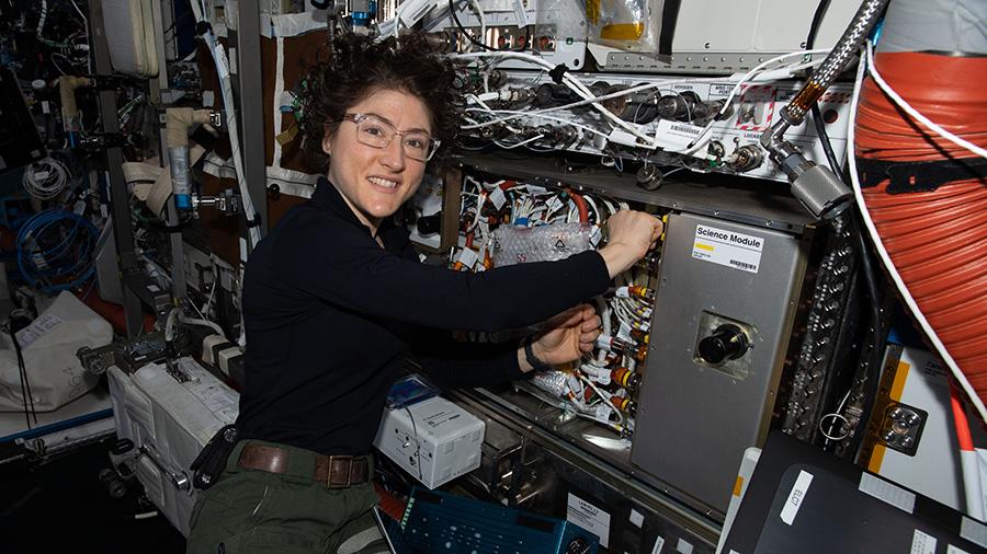 NASA astronaut Christina Koch works on the Cold Atom Lab