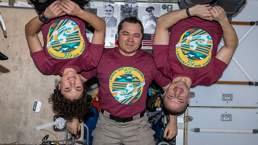 The three-member Expedition 62 crew