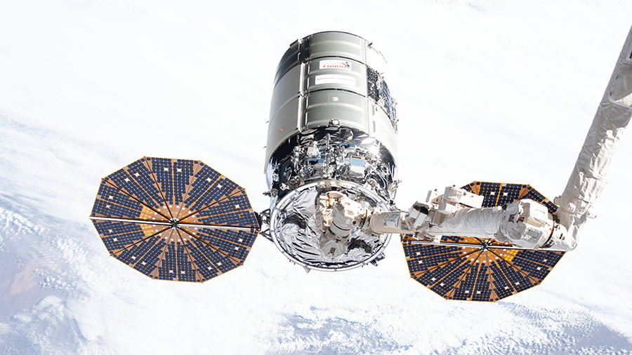 The Cygnus space freighter is pictured in the grips of the Canadarm2 robotic arm in February of 2020 during Expedition 62.