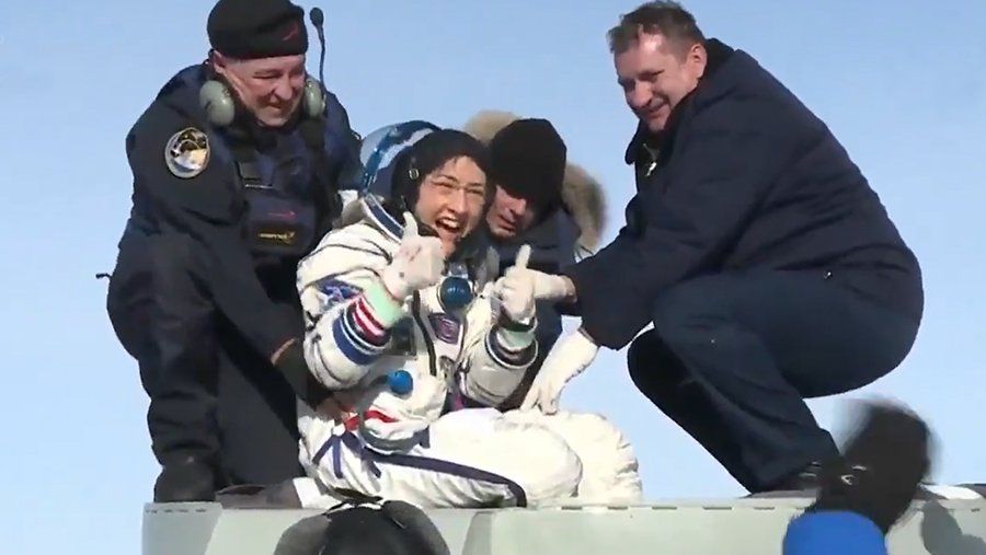 Astronaut Christina Koch smiles as she gives a