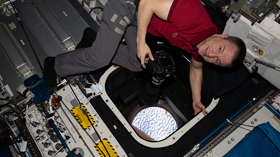 NASA astronaut and Andrew Morgan takes photographs of the Earth