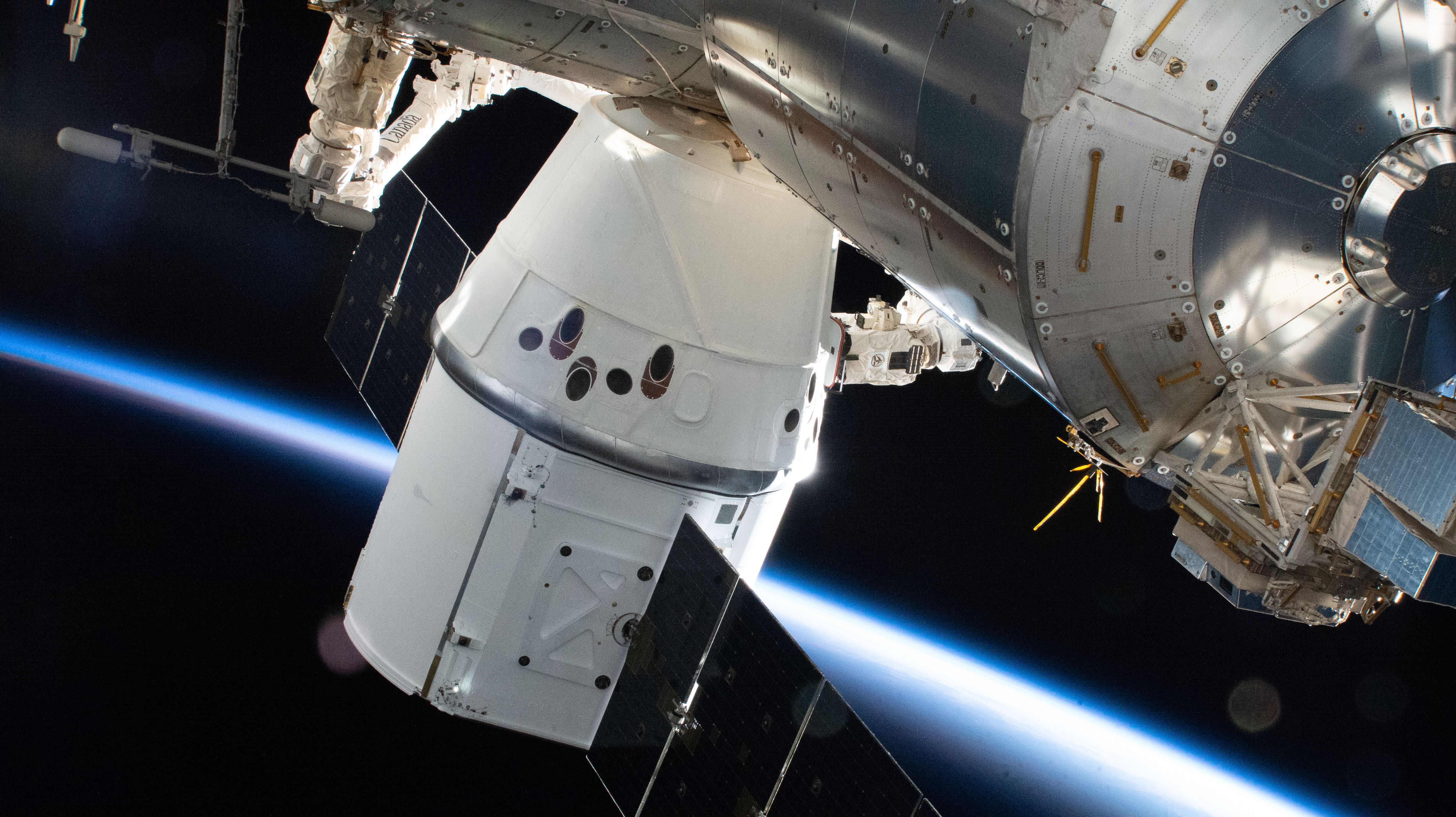 The SpaceX Dragon resupply ship is pictured attached to the Earth-facing port on the International Space Station's Harmony module.