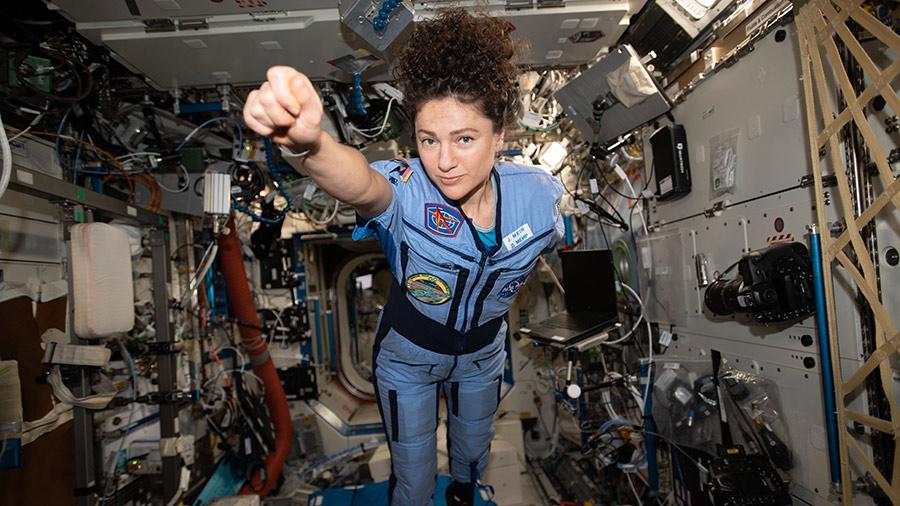 NASA astronaut Jessica Meir strikes a superhero pose