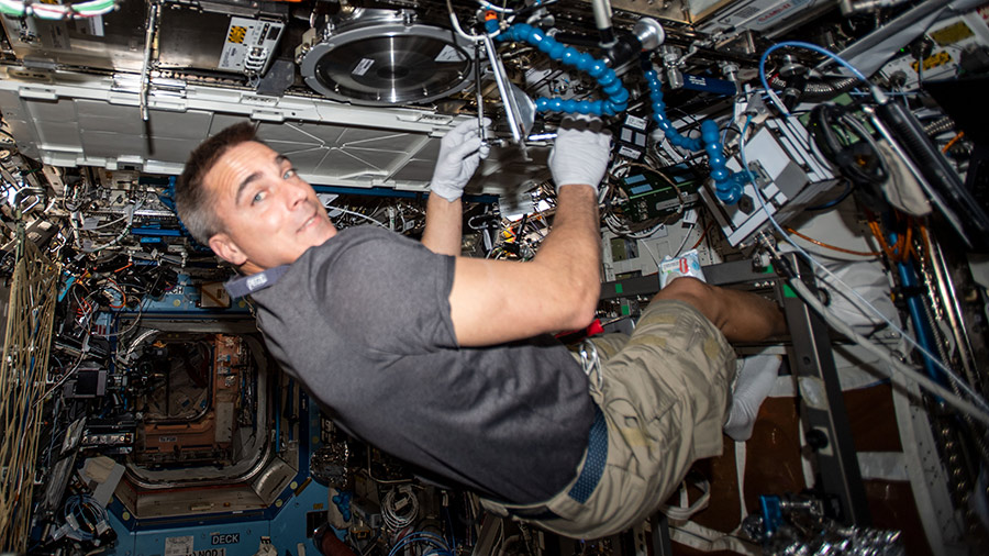 Expedition 63 Commander Chris Cassidy works in the Combustion Integrated Rack