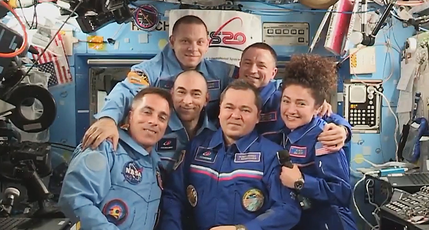 The six station crewmembers join each other for a group hug