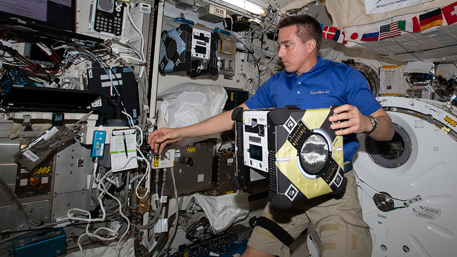 63 Commander Chris Cassidy sets up an Astrobee robotic assistant