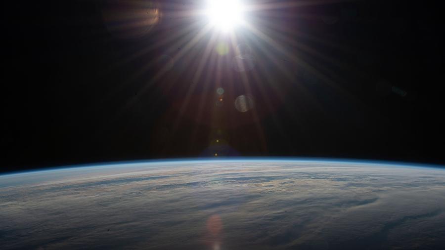 The sun's rays glisten above the Atlantic Ocean