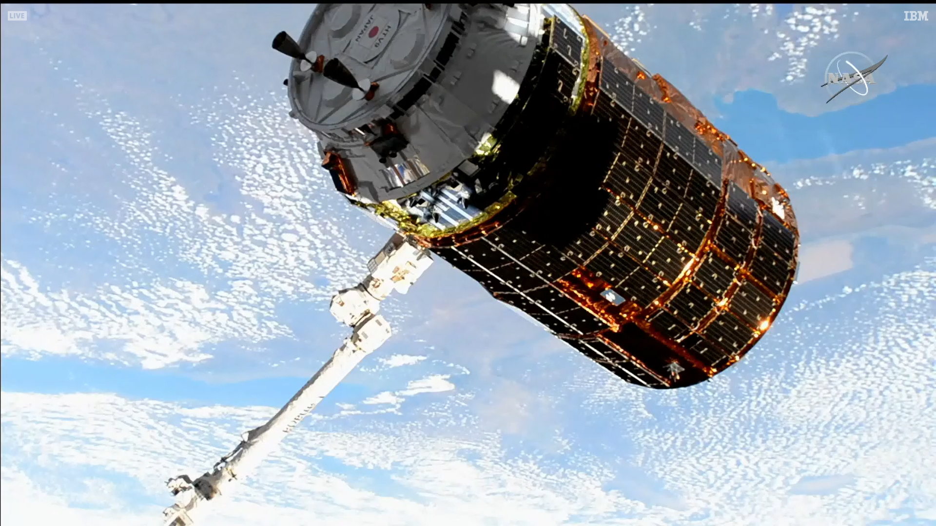 Japan's HTV-9 resupply ship is pictured in the grips of the Canadarm2 robotic arm