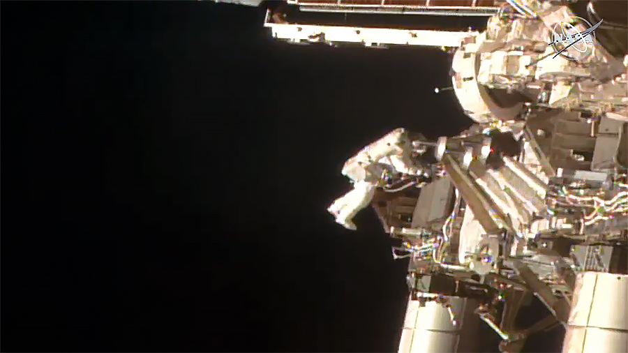 NASA astronaut Bob Behnken is pictured tethered to the space station during a spacewalk to swap batteries on the orbiting lab's truss structure.