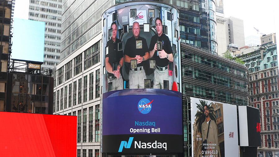 NASA astronauts pictured on the NASDAQ MarketSite in Times Square