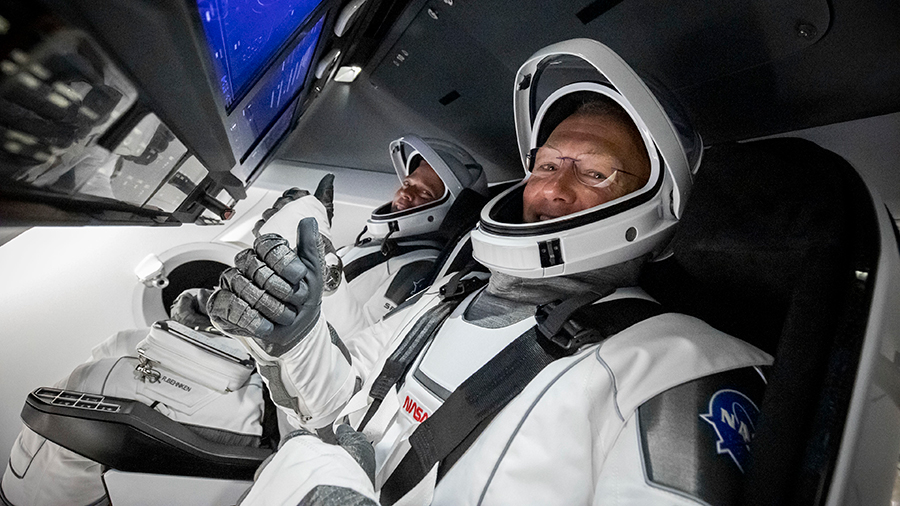 NASA's first commercial crew astronauts (front to back) Doug Hurley and Bob Behnken are pictured in January during tests inside the SpaceX Crew Dragon vehicle. Credit: SpaceX
