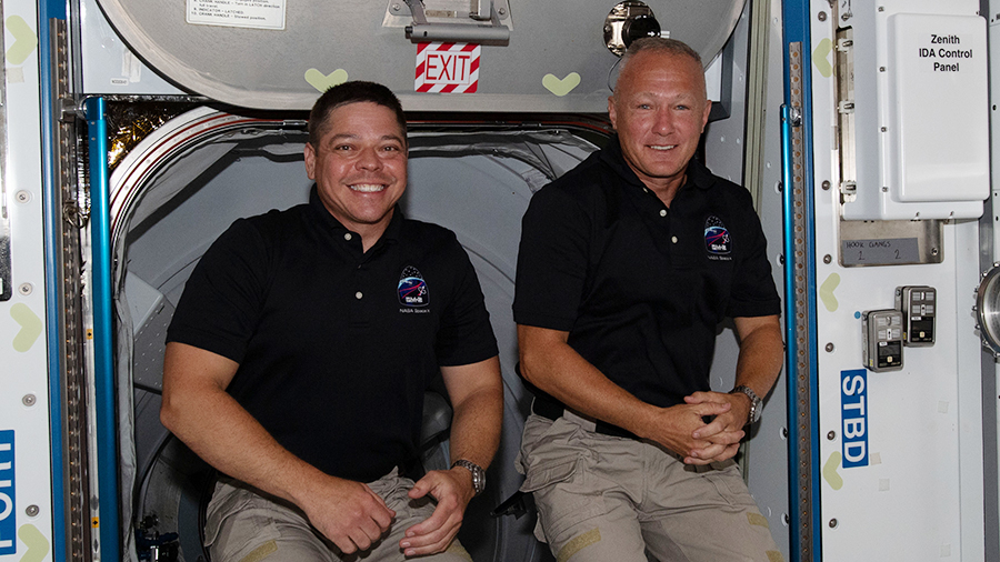NASA astronauts (from left) Bob Behnken and Doug Hurley, are pictured inside the orbiting lab shortly after arriving aboard the SpaceX Crew Dragon spacecraft on May 31.