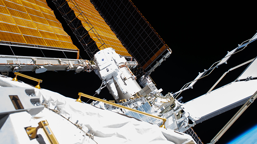 Flight Engineer Bob Behnken (center) is pictured on July 1 during a spacewalk to swap an aging nickel-hydrogen battery for a new lithium-ion battery on the station's starboard truss structure.