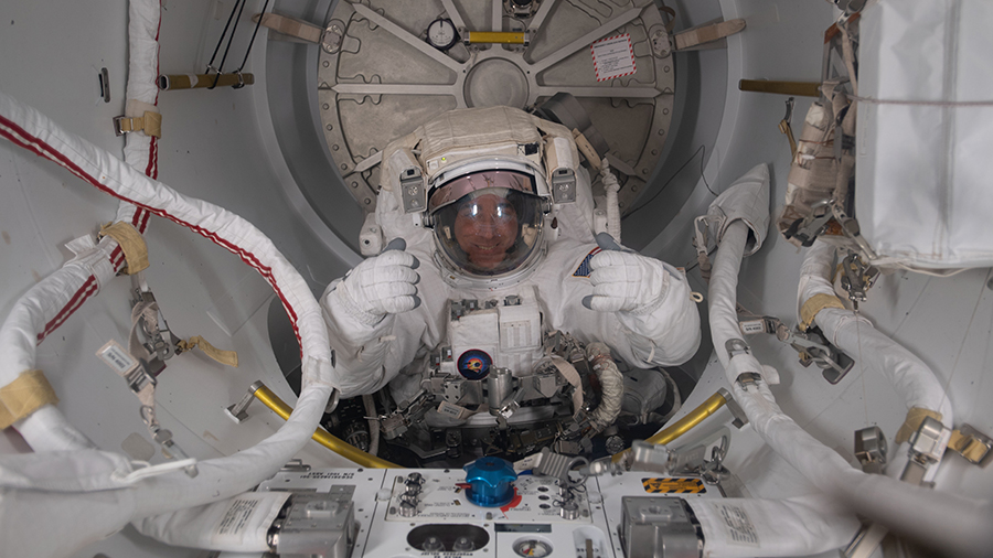 Expedition 63 Commander Chris Cassidy is pictured in his U.S. spacesuit halfway inside the crew lock portion of the Quest airlock during a spacewalk on July 1, 2020.