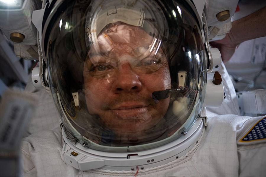 """NASA spacewalker Bob Behnken takes a """"space-selfie"""" with his helmet visor up on his U.S. spacesuit."""